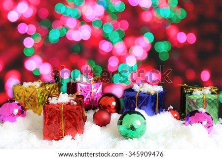 Gift box and ornament on snow and bokeh background