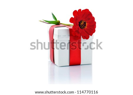 gift box and red flower close up - stock photo