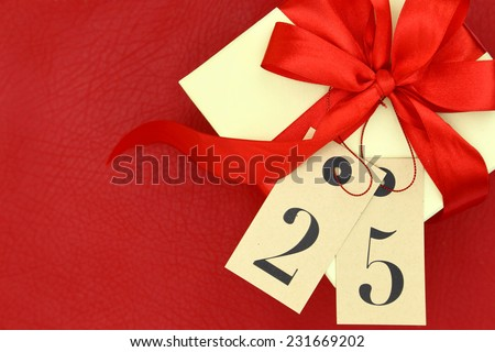 Gift box and tags with number 25 on red background  - stock photo