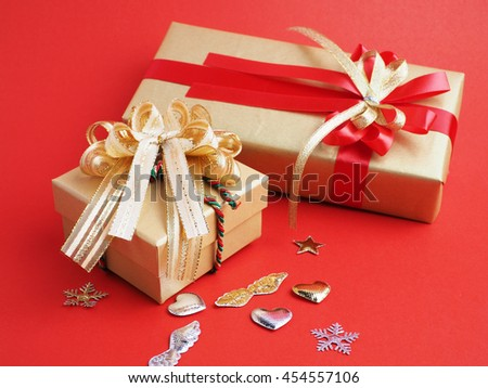 Gift box for important on red background, christmas and new year concept, close up.