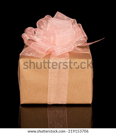 Gift box from craft paper with bow isolated on the black - stock photo