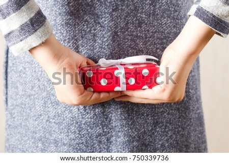 Gift box in girls hands