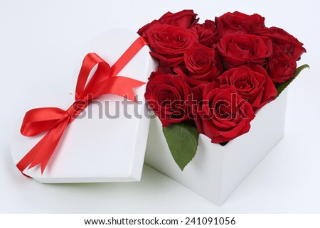 Gift box in heart shape with roses for birthday gifts, Valentine's or mother's day - stock photo