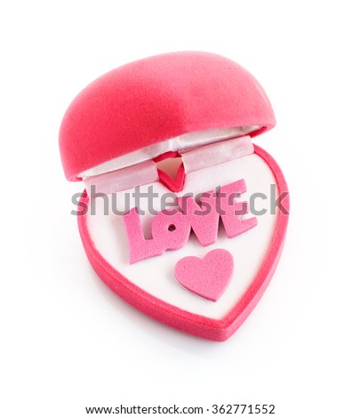 "Gift box in heart shape with word ""love"" isolated over white"
