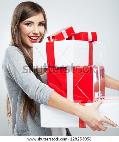Gift box in the hands of young woman. Happy woman isolated. - stock photo