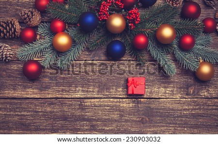 gift box near pine branches on a table. - stock photo