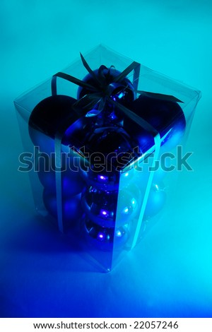 Gift box of Christmas baubles - stock photo