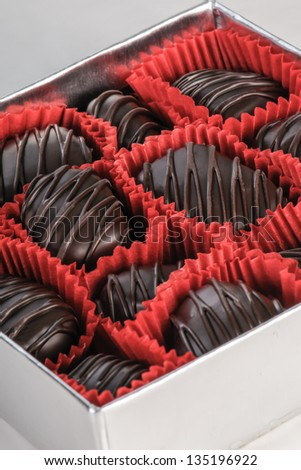 Gift box of dark chocolates - stock photo