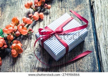Gift box on a rustic background - stock photo