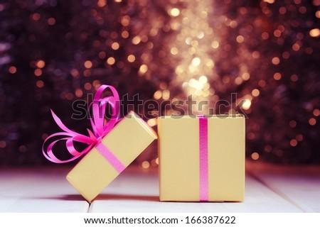 Gift box on holiday background - stock photo