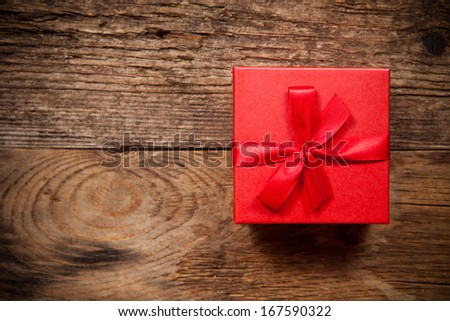 Gift box on old wooden table. Top view with place for text. - stock photo