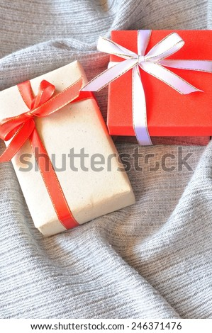gift box on the grey fabric background  - stock photo