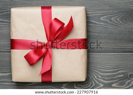 gift box on wooden table, christmas background - stock photo