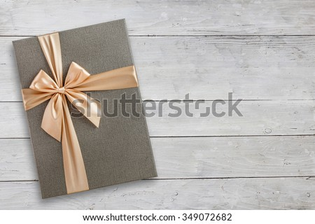Gift box over wood with copy space, top view - stock photo