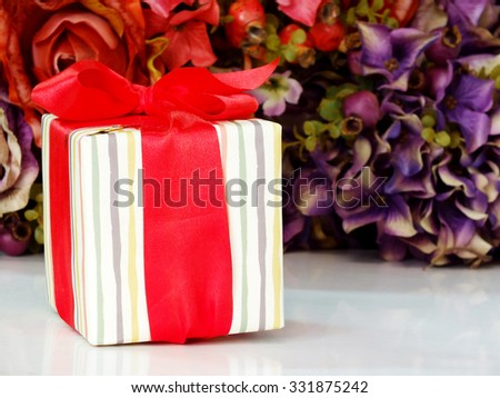 gift box present with ribbon decorations for christmas and new year festival - stock photo