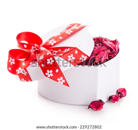 gift box ribbon red heart with flower petals Isolated on white background - stock photo