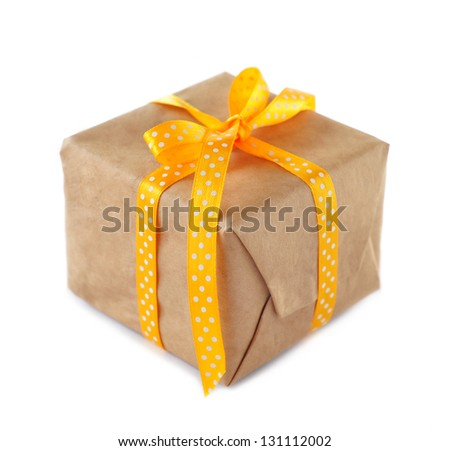Gift box tied with yellow ribbon - stock photo