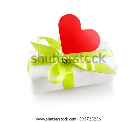 Gift box with a satin ribbon and a red paper heart. Isolated with clipping path on white background. - stock photo