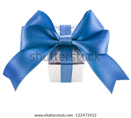 gift box with blue ribbon bow close up isolated on white background