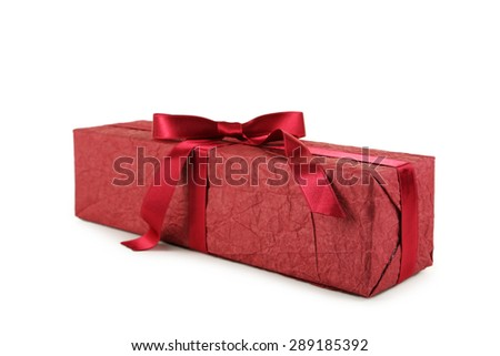 Gift box with burgundy bow isolated on white - stock photo