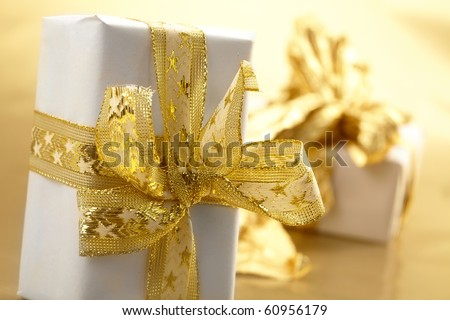 gift box with gold ribbon - stock photo