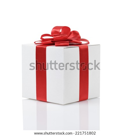 gift box with handmade red ribbon bow, isolated on white - stock photo