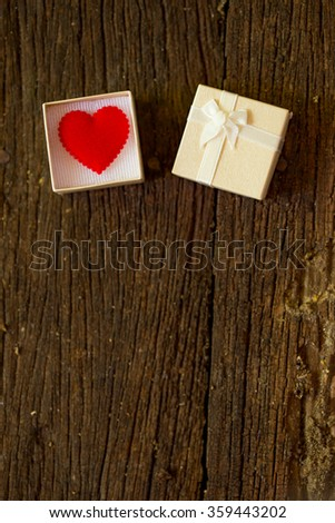 Gift box with heart on wooden table, Valentine day