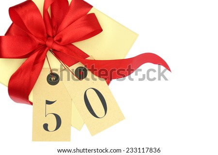 Gift box with number 50 and ribbon isolated on white - stock photo