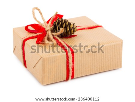 Gift box with red bow and cone isolated on white background - stock photo