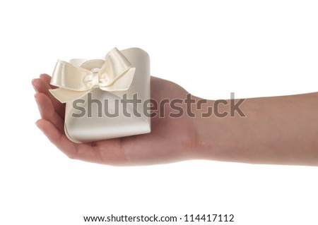 Gift box with ribbon in hand - stock photo