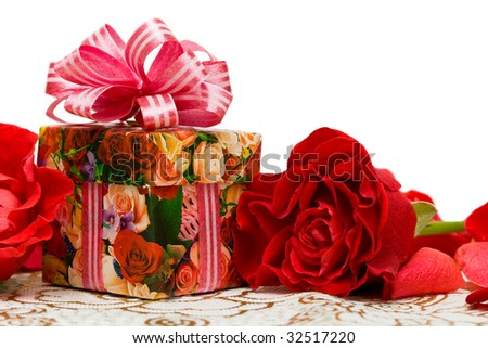 gift box with rose on a silk surface