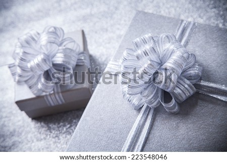 gift box with silver ribbon, glittery silver background