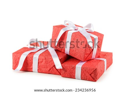 Gift box with white bow isolated on white - stock photo