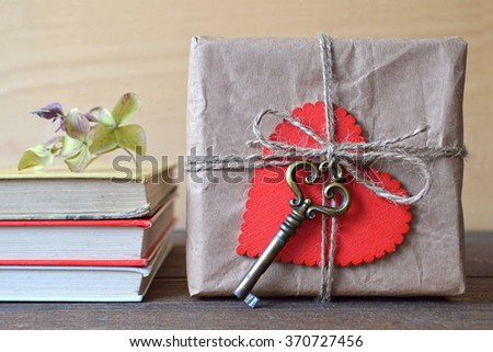 Gift box wrapped in brown paper - stock photo