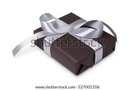 Gift box wrapped with dark paper and silver satin ribbon, isolated on white background. Modern present for any holiday, christmas, valentine or birthday