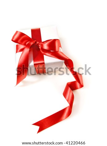 Gift box wrapped with red satin ribbon on white