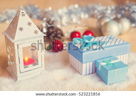 Gift boxed in beautiful Christmas surrounding