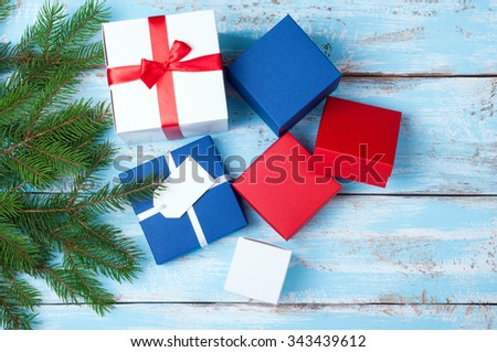 Gift boxes. Gift presents and christmas tree on wooden background. Copy space. Top view - stock photo