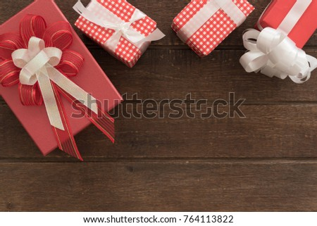 gift boxes of present for new year, christmas, birthday or anniversary on wood background. above view