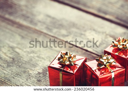 Gift boxes on defocused wooden background - stock photo