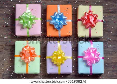 gift boxes on old wooden background - stock photo