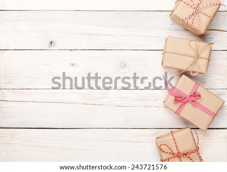 Gift boxes on wooden table background with copy space - stock photo