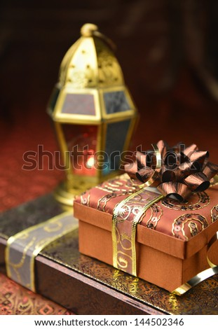 Gift boxes with arabic lantern - stock photo