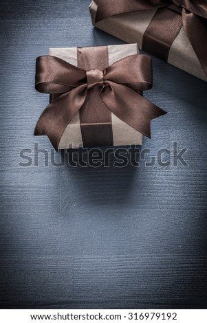 Gift boxes with bows on vintage wooden board holiday concept.