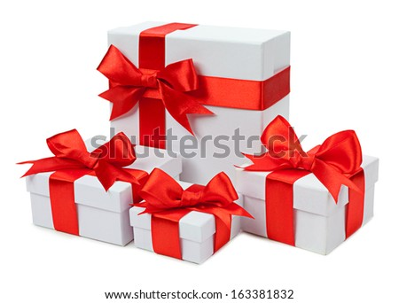 Gift boxes with red bows isolated on white background  - stock photo
