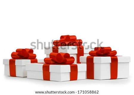 Gift boxes with red ribbon bows on white background - stock photo