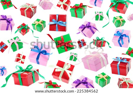 Gift boxes with ribbon and bow falling down on white background - stock photo