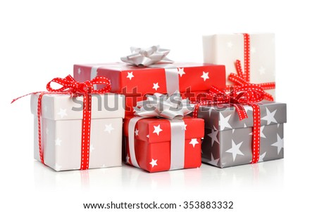 Gift boxes with ribbons isolated on white background