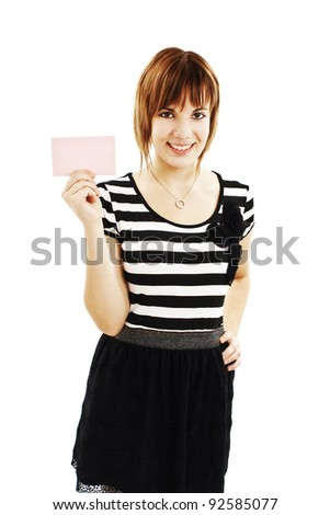 Gift card sign woman. Smiling young female showing empty blank paper note copy space. Isolated on white background - stock photo