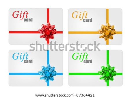 Gift cards with a  ribbon and bow - stock photo